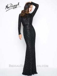 Mac Duggal 4477R is a black fully beaded, long sleeved, column evening gown with open back and small sweep train.