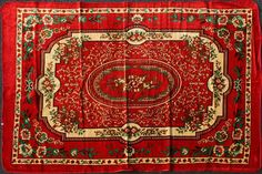 Perfect shoestring item: $17 area rugs, assorted colors, 5' x 7'.  Prayer rug thin, but a cheap way to instantly make a space more exotic.