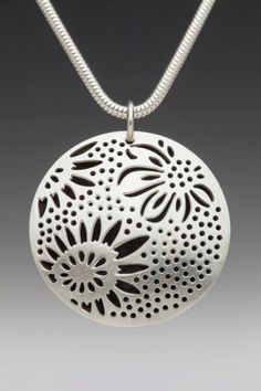 """Domed Hollow Round Oxidized Triple Sunflower Necklace.  The necklace is made of sterling silver, domed, hollow, round disks which are 1 1/4"""" in diameter. They are pierced with a design of triple sunflowers and oxidized inside the hollow form to make the design stand out using contrast. The chain is also made of sterling silver."""