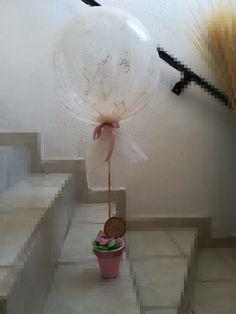 Centro de mesa bautizo niña con globos