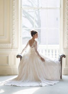 The open back, laced sleeves, and ball gown skirt are absolutely perfect! Beautiful picture too!