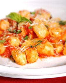 This mouthwatering Italian recipe for gnocchi with tomato sauce was adapted from Martha Stewart Living, February 2004.