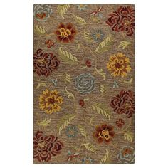 Wool rug with a scrolling vine motif. Hand-tufted in India.   Product: RugConstruction Material: 100% Wool