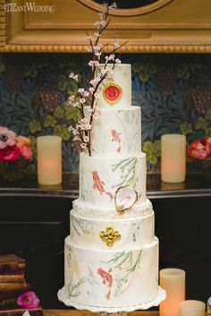 Cherry blossom and koi fish wedding cake for a Chinese wedding! BEAUTY & THE EAST FAIRYTALE WEDDING IDEAS www.elegantwedding.ca