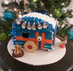 Yummy Gingerbread Vintage Trailer - fruit rollups for the siding, cookie wheels and a string of snowmen lights.