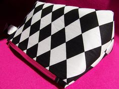 White Cosmetic Bag With Black Diamond Shapes, Light Blue Lining , Inside Small Pocket  And Pink Zip