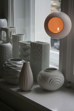 White vases in different shapes and textures.