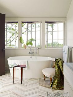 The master bath is a spa-like oasis, with sumptuous but minimal furnishings. Design: Ruard Veltman -- love the tub and the tile work