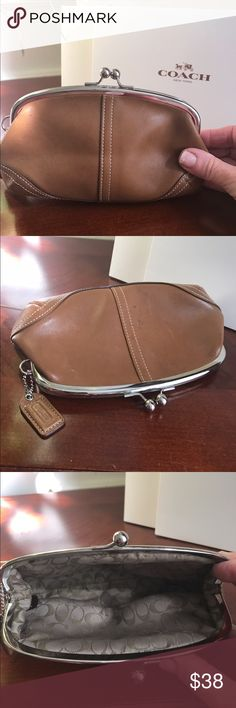 Authentic Coach Leather Kisslock Wallet Authentic Coach Leather Kisslock Coin Purse, wallet, Cosmetic Case. Soft glove tanned leather. ink mark on front, otherwise in Excellent condition. Coach Bags Clutches & Wristlets