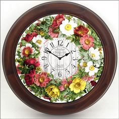 """This clock is so vibrant and beautiful you can almost smell the aroma from the Wild Roses The Clock has a brown or a black frame with a protective lens. in sizes 12"""" to 36"""" http://www.clocksaroundtheworld.com/floral-wall-clocks.html"""