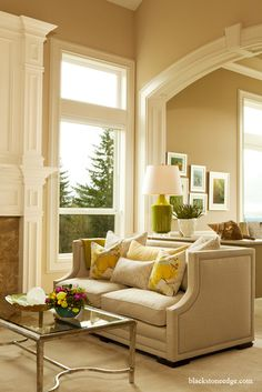 Bleeker Beige Benjamin Moore.  This color really highlights white mouldings.  Very soothing.
