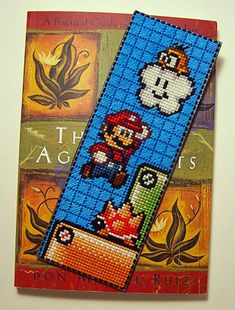 Super Mario Bookmark! - Finish this pattern off with a scottish stitch as shown in the finished photo to really make this bookmark shine.    Fabric