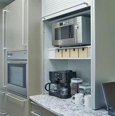 Theres plenty of compartmentalized storage in this galley-style kitchen. A 15-inch-deep tambour-door garage hides smaller appliances.