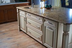 This kitchen island has two pots & pans drawers, a cutlery tray and a pull-out trash can!