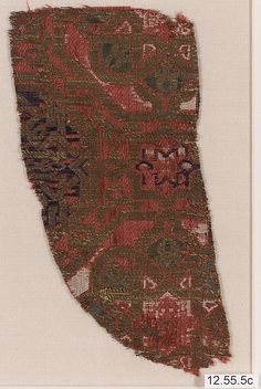Fragment Date: 14th century Geography: Spain Culture: Islamic Medium: Silk Dimensions: Textile: L. 6 in. (15.2 cm) W. 3 in. (7.6 cm) Mat: L. 12 in. (30.5 cm) W. 9 in. (22.9 cm) Classification: Textiles-Woven