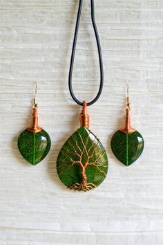 Tree of Life copper wire wrapped Green Leaf in Resin pendant and matching earrings