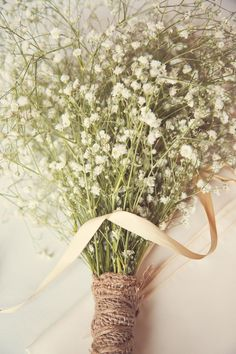 A fresh, simple baby's breath bouquet perfect for a rustic wedding. Before your wedding, pick a few flowers from your bouquet and ask a bridesmaid to send to the groom with a note to wear it in his jacket pocket as you walk down the aisle.