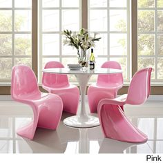 Refresh your dining space with this vibrant set of four chairs by Verner Panton. With a unique 'S' shape design and a choice of four brought colors, these chairs bring life even to the most boring fur