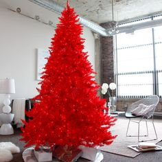 Red Ashley Pre-lit Christmas Tree by Sterling Tree Company - Bring a bright and festive look to any room this holiday season with the Red Ashley Pre-lit Christmas Tree . You'll have family and friends cavorting...