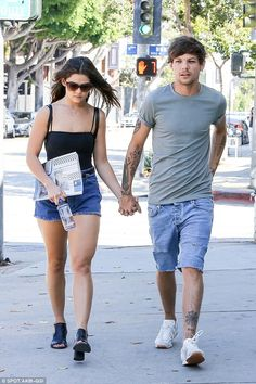 His number one: Louis Tomlinson and girlfriend Danielle Campbell held hands as…