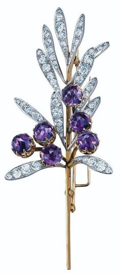 We're used to seeing the wonderfully inventive glass creations of Lalique, but it's nice to see his work with gems and precious metals too, as in this 1894 spray brooch for Tiffany. It's composed of 12 platinum leaves set with diamonds, and 6 rose-cut amethysts set in gold.