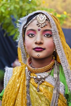 Portrait of a Young Girl in Goa !    Stately, comely and dressed in a fine dazzle of yellow and green.  Decked with silver bling plus a dash of pearls and gold  The Girl who will be a woman  Soon !    This is from a group of giggly girls