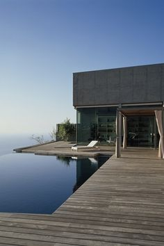 by CA+A Architects Pool with decking, negative edge