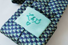 """Sneak a small patch onto the back of the groom's tie before the wedding day.  Have it secretly embroidered with your initials in blue thread for """"something blue"""". Cute idea! By The Merriwether Council."""