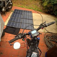 Instagram picutre by @tims_electric_miles: Charging with solar pannels for the first time. Its a still really over cast and the suns very low in the sky but it works. #solar #clean #ebike #adventure #riding #cycling #California #roadtrip #coolstuff #electric #hpc #specter50 #lev #EbikeUSA #electricbike #fun #chill #life #sustainable #green #transportation #touring @s.t.electricmiles #speed #fast - Shop E-Bikes at ElectricBikeCity.com (Use coupon PINTEREST for 10% off!)