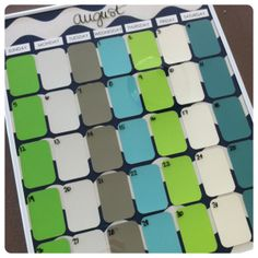 DIY Dry erase calendar.  Using paint chips, fabric and a picture frame