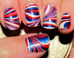 Red, white, and blue water marbled nails.
