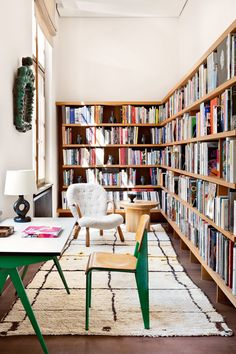 Lovely and very stylish home library with seating space