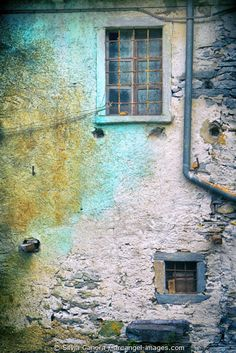 Decayed windows on a weathered wall with gutter - ©Silvia Ganora Photography - All Rights Reserved  #bookcovers #decay #windows #architecture