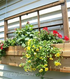 Simply Swider - old window into outdoor planter window box decoration - via Remodelaholic