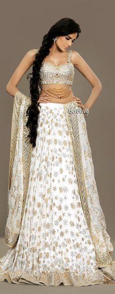 White and gold lehenga. Indian bridal fashion.