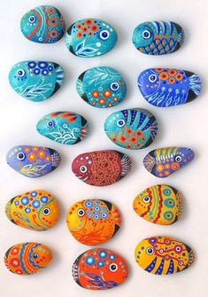Painted rocks, made into fish magnets