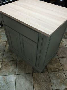 Island with a maple butcher block top by Sanford Woodworks!