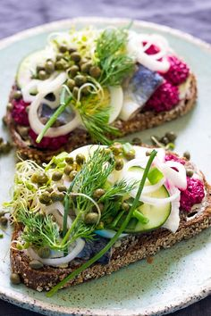 If you want to know what Danish cuisine tastes like, you have to make Herring Smørrebrød. It& an open-faced sandwich that is sure to blow your mind. Danish Cuisine, Danish Food, Herring Recipes, New Recipes, Healthy Recipes, Healthy Cafe, Seafood Recipes, Open Faced Sandwich, Brunch