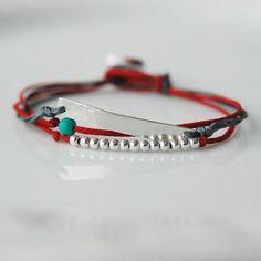 Multi-strand bracelet with button clasp