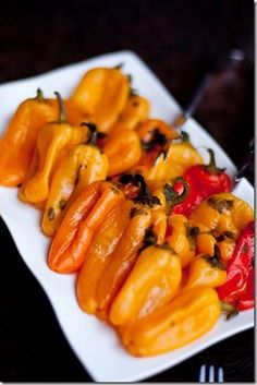 Feta Cheese Pickled Mini Bell Peppers | Gently roasted peppers marinated in a mixture of vinegar, garlic, onion and parsley.