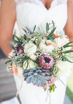 How to choose an alternative to peonies for your wedding bouquet and still have a beautiful selection of blooms!  Use this guide to peony substitutes by season to create a stunning look - using ranunculus, double flowering tulips and more! We love this bouquet for its slightly bohemian style thanks to the burgundy, peach and succulents. © kirstymackenziephotography.co.uk