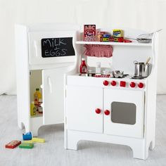 Playtime really cooks with this wooden play fridge and kitchenette. Fridge has separate freezer and refrigerator compartments with shelves on each door. But that's just the tip of the icebox. Coordinating kitchenette has a play stovetop and removable, stainless steel kitchen sink with turning knobs. Safety first - Includes Tip Restraint Kit for securing Kitchenette and Fridge to your wall to prevent tipping Details, details - Nod exclusive - Kitchenette has upper display shelf and includes…