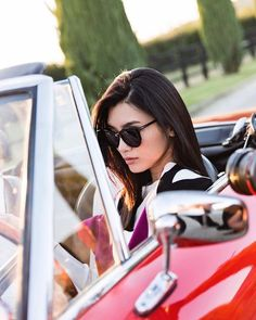 In the driver's seat with @mingxi11 and her favorite travel companion: 😎 #FerragamoEyewear