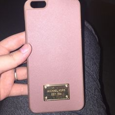 """MICHAEL KORS IPHONE 6 PLUS CASE GORGEOUS AUTHENTIC MK IPHONE 6 PLUS PHONE CASE...The pictures are a little deceiving. Do me a favor and look up the color """"dusty rose""""... That is exactly the color of the phone case. Tiny crack on bottom left of case. Barely noticeable. Willing to negotiate all prices! Make an offer! Michael Kors Accessories Phone Cases"""