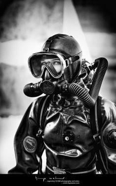Dressed for winter diving, zipped up in her thick rubber Viking drysuit, with a Technisub full face mask strapped to her pretty face, connected to a vintage Mistral twin-hose regulator. Scuba Wetsuit, Technical Diving, Scuba Diving Equipment, Scuba Girl, Diving Suit, Swimming Diving, Heavy Rubber, Full Face Mask, Rain Wear