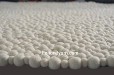 Felt ball rug in stunning natural white colorsfree by feltnyarn, $190.00