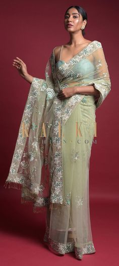 Sage green saree fabricated in embroidered net. Adorned with resham embroidered floral pattern along with sequins and cut dana work. Green Saree, Net Saree, Saree Dress, Party Wear Sarees, Beautiful Saree, Green Fabric, Saree Wedding, Fringes, Sage