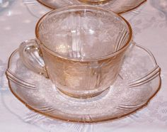 American Sweetheart Cup & Saucer - Pink    MacBeth-Evans Glass Company - ca. 1930-1936.       Saucers are more common than cups and represent about one quarter of the value of these sets.