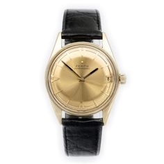 Zenith automatic 18ct gold via MarCels. Click on the image to see more!
