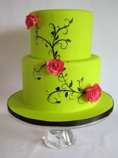 Perfection - THE Lime green wedding cake. Flowers orange. But the black stemming is amazing